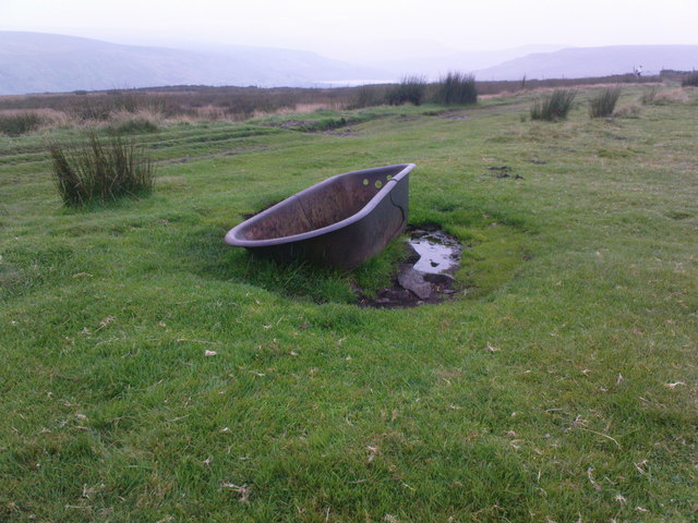 Old, rusty bath in a field